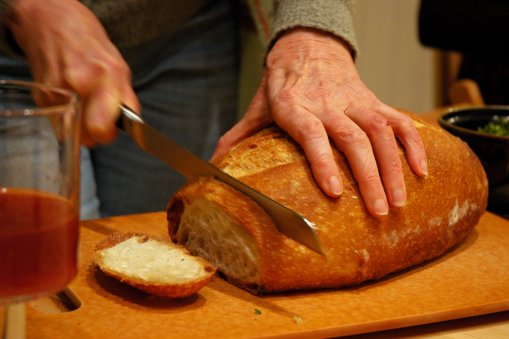 Breaking_bread,_juice,_dinner_party,_Broadview_townhouse,_Seattle,_Washington,_USA.jpg